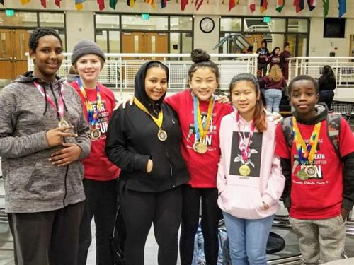 Debate team with medals