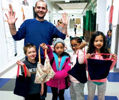 Teacher with students and homemade breakfast bags