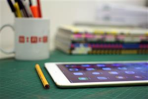 iPad on desk.