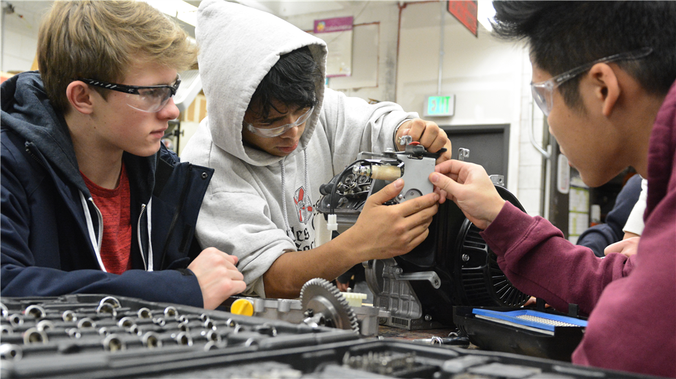 Students working in small engine repair class.