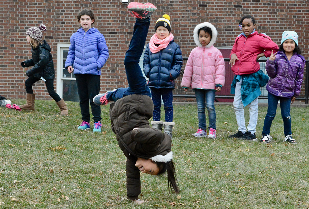 Photo of students playing outside.