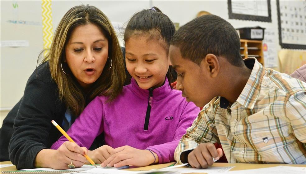 A teacher working with students.
