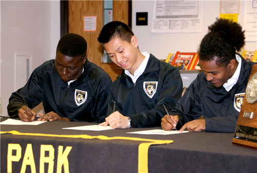 College Bound Senior Soccer players signing their letters of intent