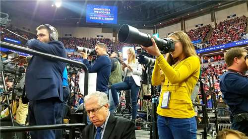 Margot photographing the President of the Unuted States from the media risers