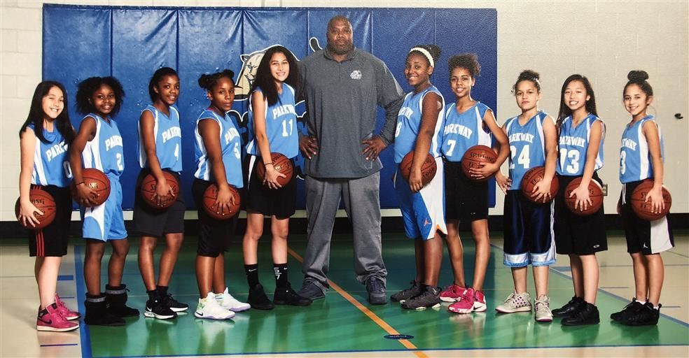 Girls Basketball team with coaches
