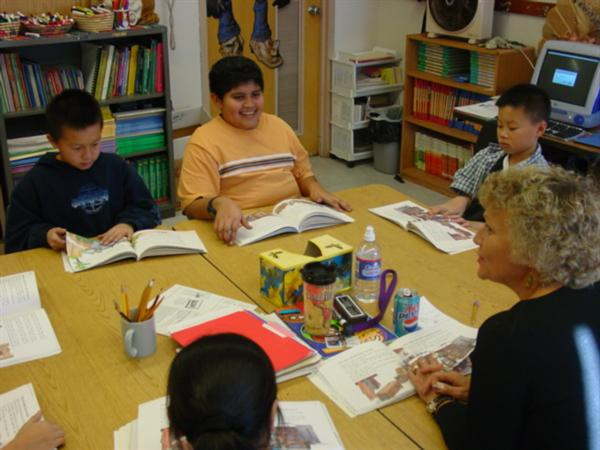 ELL Teacher Mary Haffner stimulates conversation.