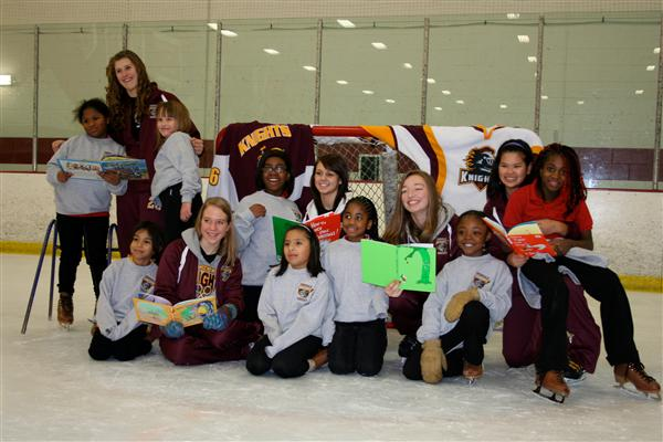 Four Seasons girls and the Irondale Hockey team share a love of reading!