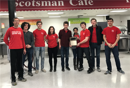 Scots math team holding up the hardware after winning the conference championship.  Pictured from left to right is Coach Mike