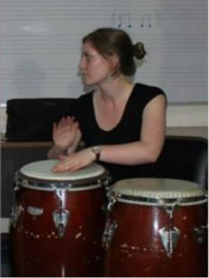 Mlle. Curran playing congas in Costa Rica on a trip with the UMN percussion studio.
