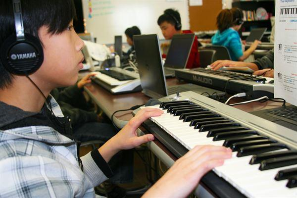 Kid playing electric piano