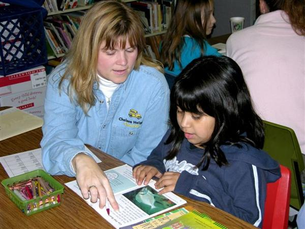 volunteer reading with student