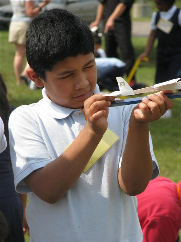 Student with model airplane